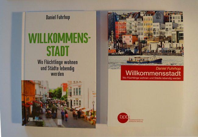 Zwei Buchcover Willkommensstadt